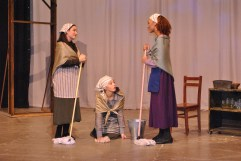 The three daughters contemplate their fate at the hands of the village matchmaker.