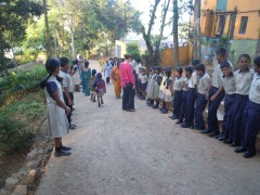 Like royalty we were greeted by the students lined up in their uniforms to give us each a flower and a special message.