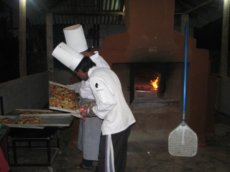 The wood fire oven delivered dozens of pizzas into the stomachs of the hungry party-goers.