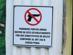 A lot of guns and gangs in El Salvador. There was no packing heat allowed in this business.