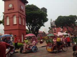 The old city hall is packed with people, cartoon themed cycle rickshaws and souvenir shops now.