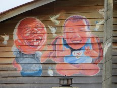 Here's a good mural. Couple a buds having a laugh with birds flying around. Makes sense.