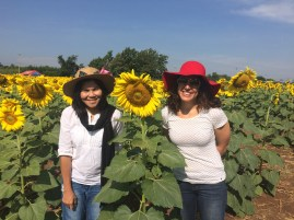 Luck and Trina in found some hats and sunflowers.