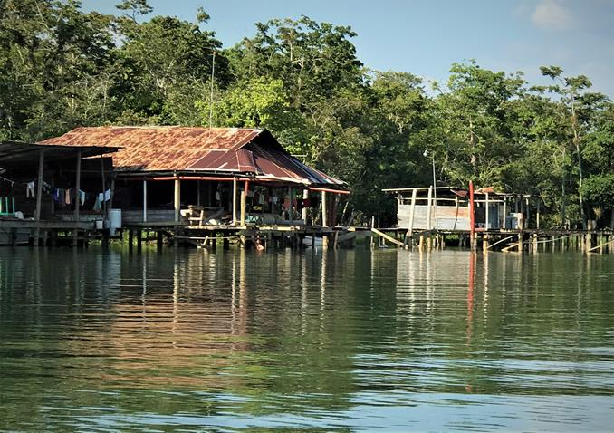 Fisherman's house on stilts in the river of Rio Dulce