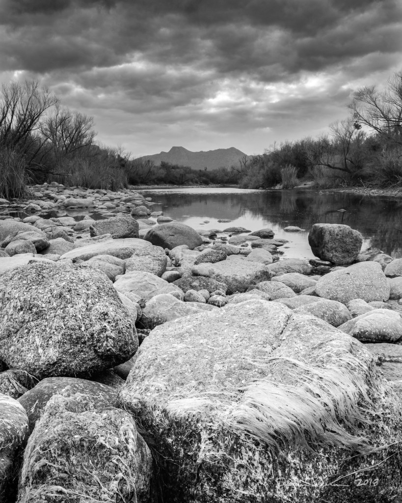 Black and white photo of boulders in the Salt River, Arizona