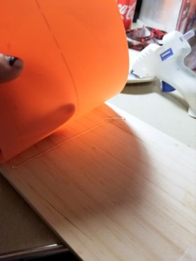 Gluing a piece of plastic to a piece of balsa wood