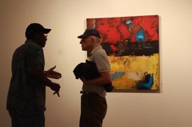 two men discussion art minneapolis