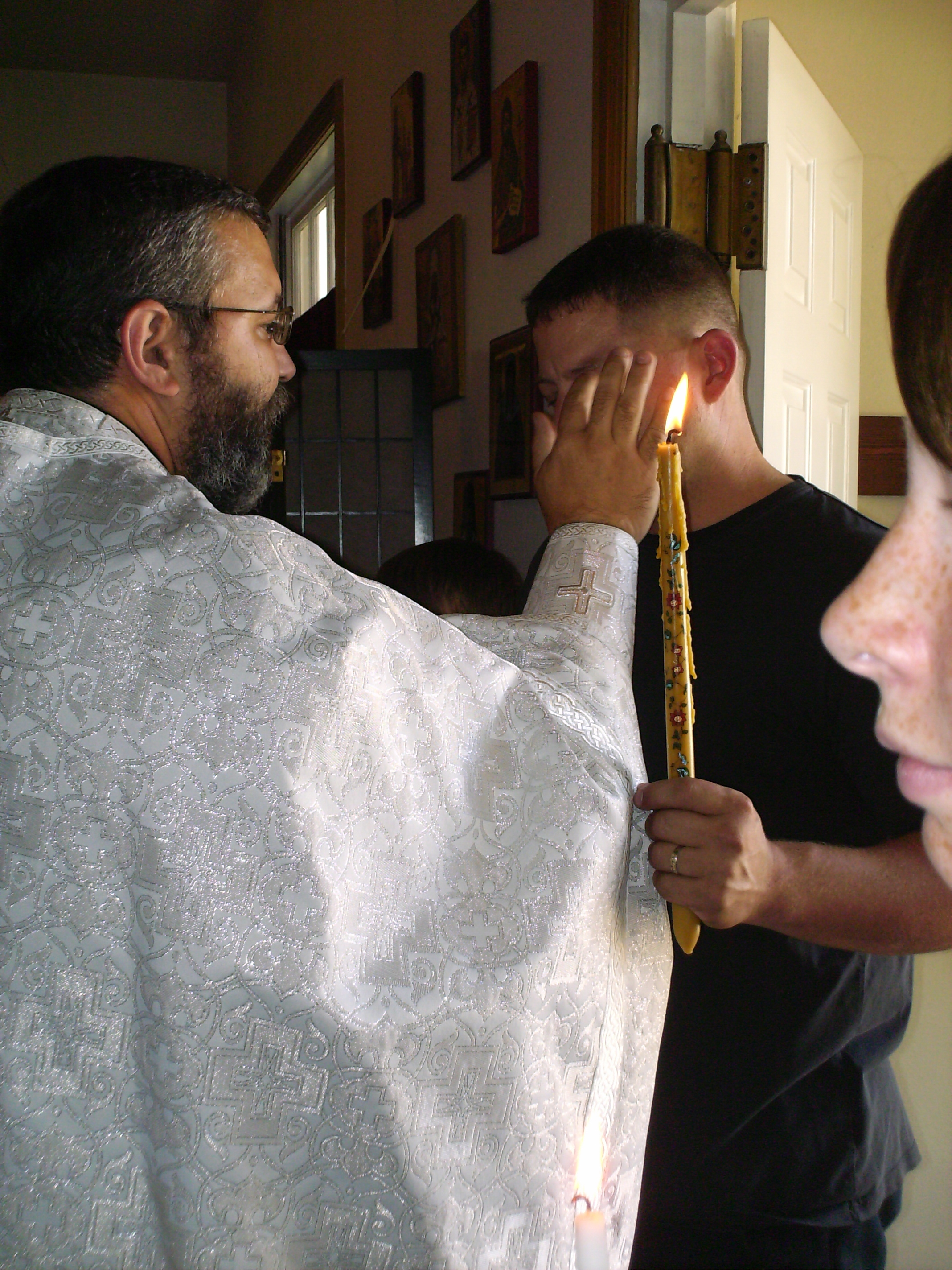 Being anointed with oil before Baptism