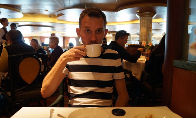 Shawn-sipping-on-some-tea-on-an-Alaskan-cruise