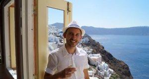 Stunning Santorini Greece - Drinkinng wine overlooking Santorini