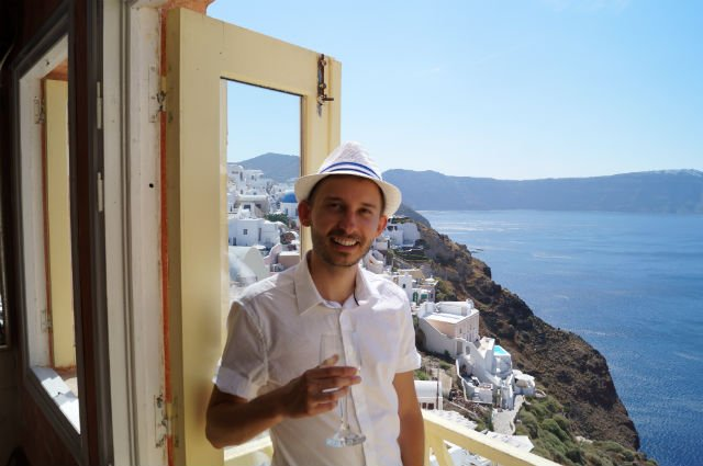 Stunning Santorini Greece - Drinking wine overlooking Santorini