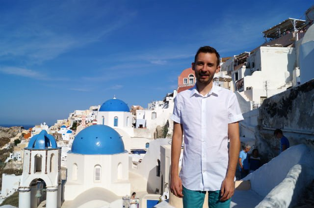 Stunning Santorini Greece - Shawn in front the blue dome in Oia
