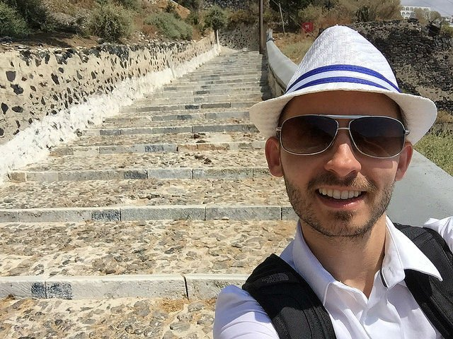 Stunning Santorini Greece - Shawn trekking down the steep pathway