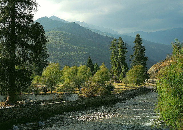 Challenges of Bhutan - River with beautiful mountains in the background