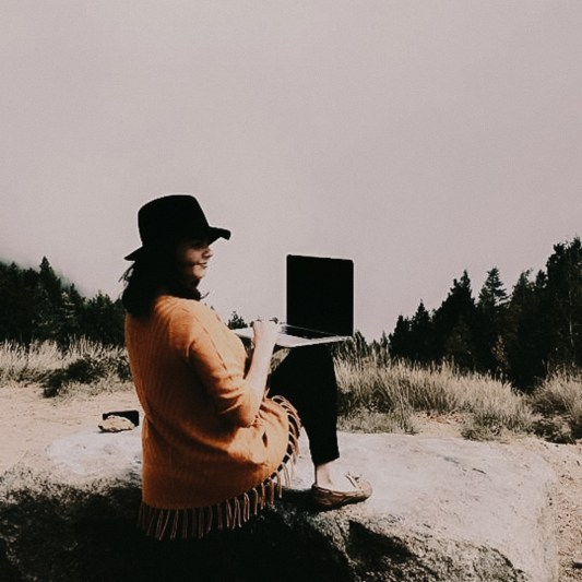 Shayla Marin- Macbook in the Mountains
