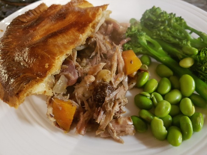Plate of food including pie and vegetables