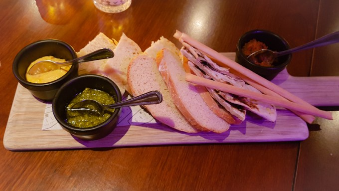 Overhead shot of breadboard with dips / The Grill in the Park, Worsley / SHE-EATS