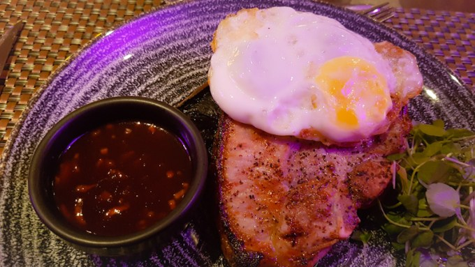 Slose up of pork steak with fried egg on top at The Grill in the Park, Worsley / SHE-EATS