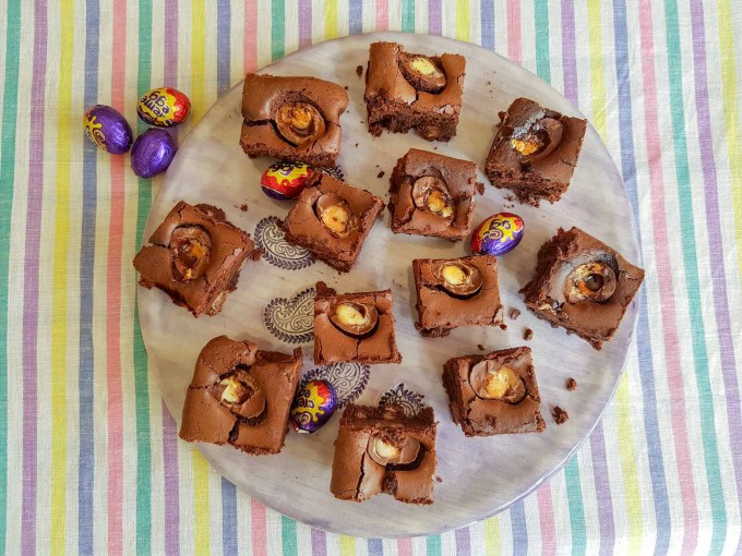 A dozen creme egg brownies on a plate