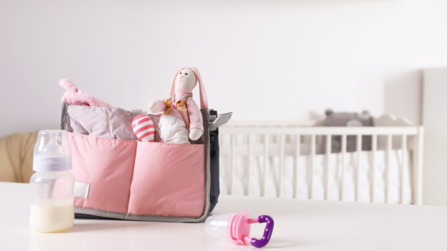 baby gear from a baby registry bag, toys, crib