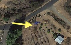 Current execution site, dead body under tarp and what looks to be blood on ground by arrow