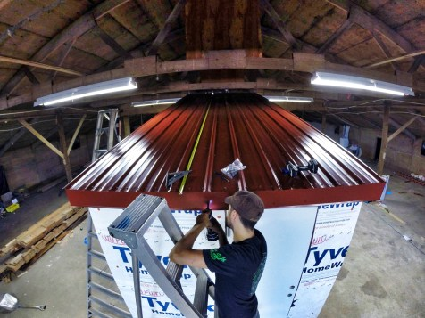 installing the metal roof panels