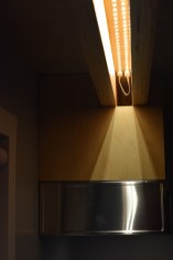 """Turns out our double loft beam detail is a nifty place to hide tape lighting. This hidden illumination sheds light onto our kitchen sink and the two flanking 12"""" counter spaces."""