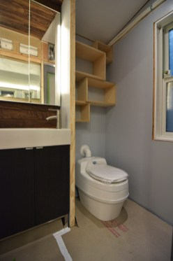 We reused some nesting modular boxes that robert built a few years back as our bathroom shelving!