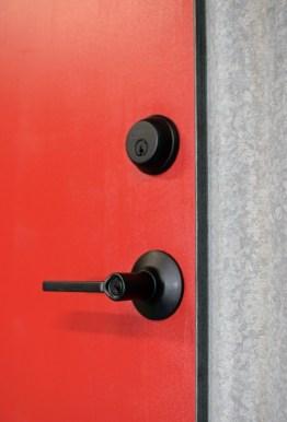 Reclaimed siding at gear room door detail