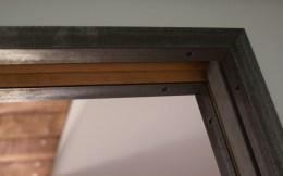 Steel angle pocket door trim