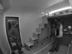 "Installing the interior wooden plywood ""waterfall"" stairs."