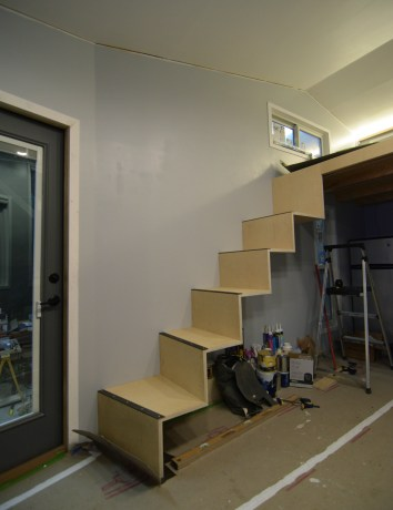 The stairs after installation and before the storage is built beneath.