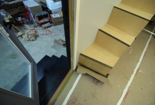 Exterior stairs, interior stairs and our moment of entry.