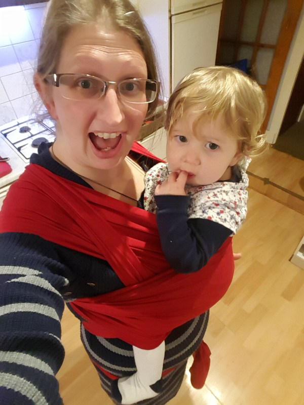 Red Izmi Bamboo wrap with 15 month old