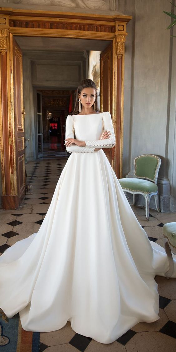 15290a985fc9 jesus peiro You will channel your inner Meghan Markle in one of these  romantic minimalist wedding dresses