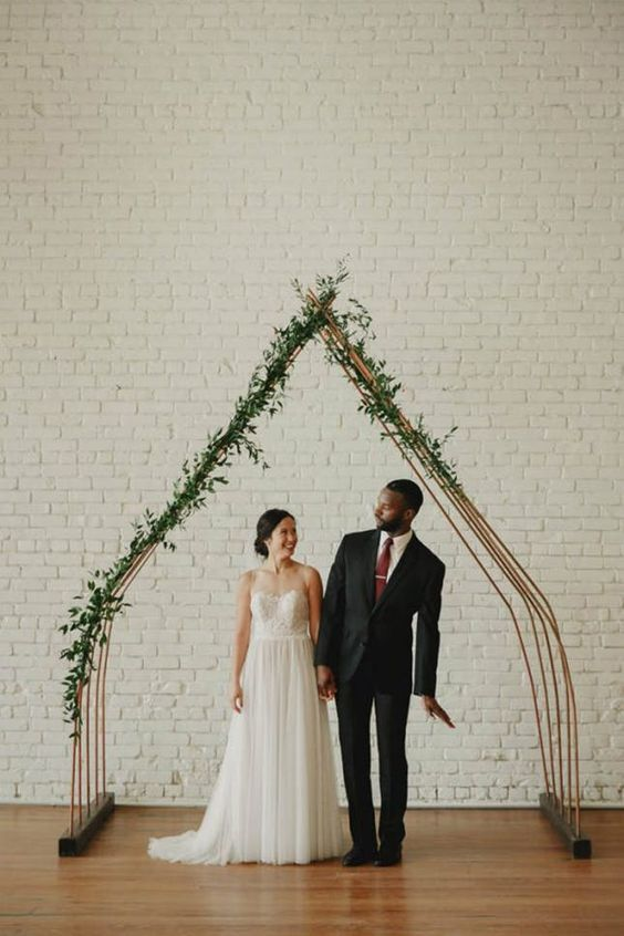 https://www.brit.co/triangle-ceremony-arches-wedding-decor-trend/