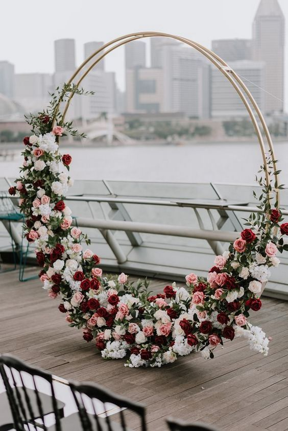 https://ohbestdayever.com/2018/12/19/trending-top-20-circular-wedding-arch-ideas/2/