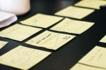 image of post its notes on a desk, one message written out that says Kill me now