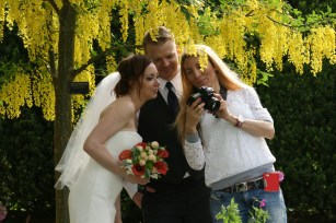 Checking the Wedding Pics Copyright Shelagh Donnelly
