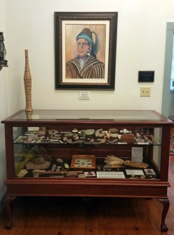 """Many descendants of Chief Menewa, the """"Great Warrior,"""" come to the museum to learn more about Creek Indian history. The Lee room contains a display of arrow heads, tomahawks and other Indian-Era artifacts."""