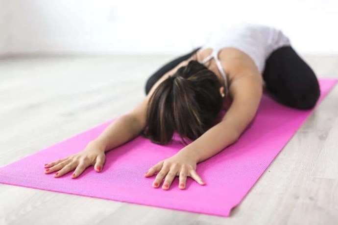 woman doing yoga in child's pose