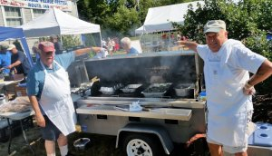 Grill masters Ralph Krau and Steve Hoxie