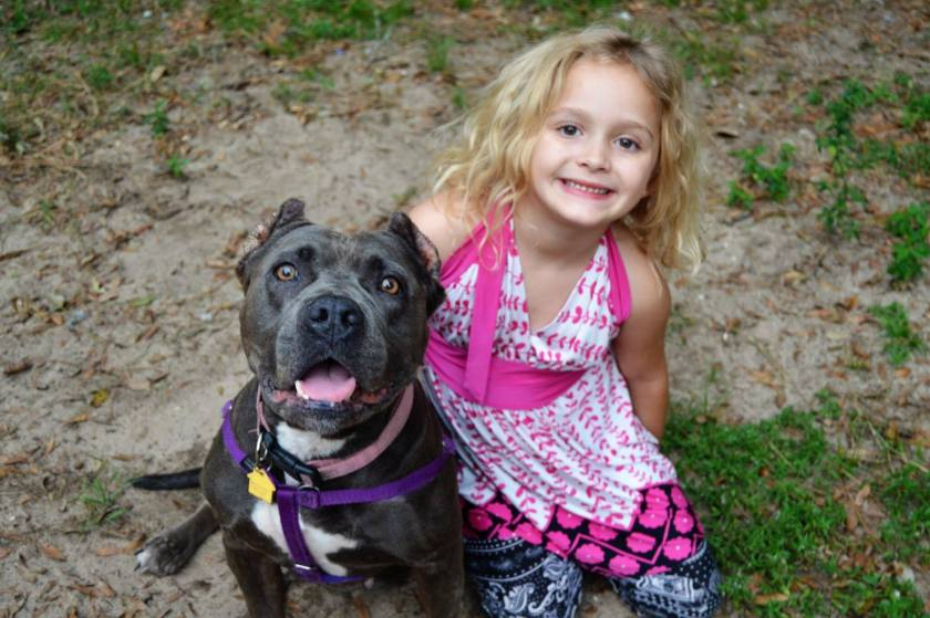 Kendall, a FL adoptable girl, sharing smiles with foster sister Haley
