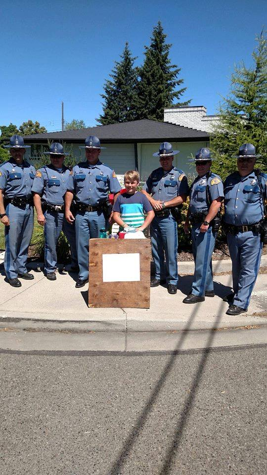 Troopers Show Up To Support Boy Raising Money To Adopt A Dog