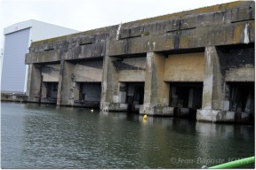 This shot was taken in June 2015 from a boat. It can bee seen a sheds installed close to the U-Boot-Bunker.