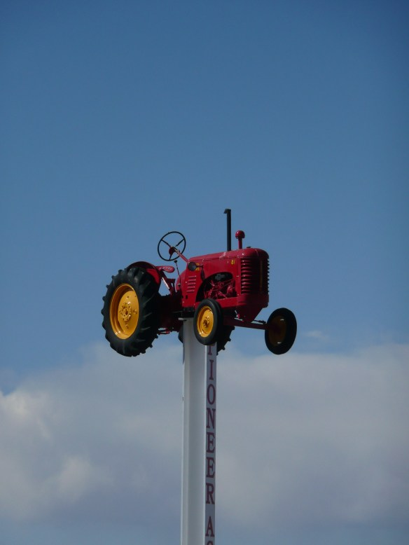 Red Tractor...where else?  Suspended before a blue screen of Alberta sky.