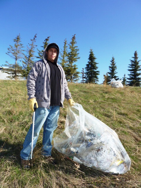Corey, paid by the City of Calgary to pick up other people's garbage.