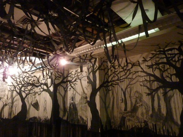Viewers in Jennifer Crighton's scary fairy tales installation.