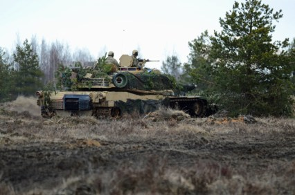 Abrams moving into firing position