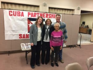 Pastors and guests from San Nicolas de Bari Presbyterian Church in Cuba and Shepherd of the Valley Presbyterian Church in Albuquerque, NM pose in front of their Cuba Partnership banner